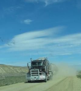 An oil truck envelopes us in dust. Click to enlarge.