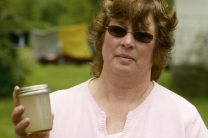 Carol French displays her contaminated drinking water.