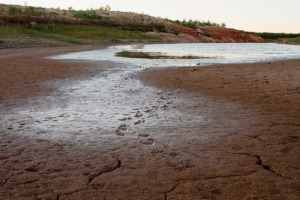 A view of the dry bed of a reservoir in Texas. Records show that environmental officials have granted more than 50 aquifer exemptions for waste disposal in that state. Courtesy of ProPublica