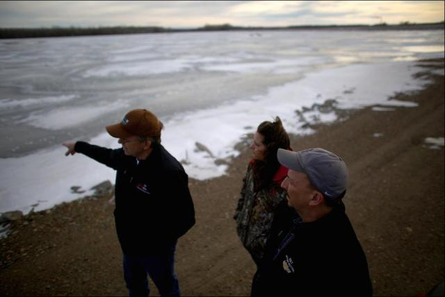 Mayor Rick Norby (right) and two staff members inspect one of Sidney's wastewater lagoons, which needs to be replaced by modern treatment plant. Photo: David Gilkey, NPR