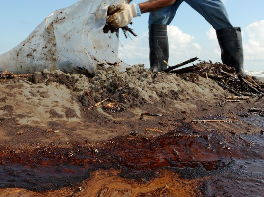 Cleaning up an oil spill on the Blackfeet Reservation. Photo: Associated Press